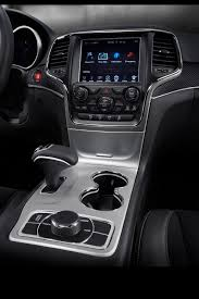 grey jeep grand cherokee interior 2015 jeep grand cherokee srt adds 5hp red vapor special edition