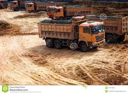 golden trucks trucks at construction site stock photos image 34724853