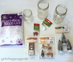 winter scene in a mason jar in the garage
