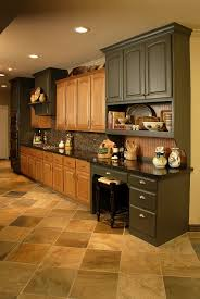 existing oak cabinets used with some new painted cabinetry