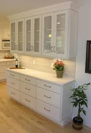 Kitchen With White Cabinets by Woman Standing In Tall Aisle Kitchen With White Brick Wall White