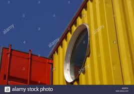red blue yellow window circle corrugated steel metal container
