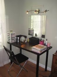 black diy vanity table with minimalist design and folding chair
