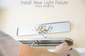Replacing Bathroom Light Fixture How To Install A Bath Light Fixture Light Fixtures