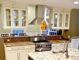 a kitchen peninsula better than an island kitchen peninsula with glass door cabinets and deep crown molding