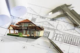 construction plans construction plans and drawing tools on blueprints stock photo