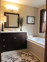 attractive bathroom wall color with dark cabinets