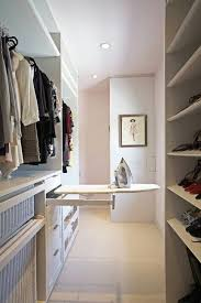 ironing board closet cabinet 28 easy solutions to your closet problems ironing boards iron and
