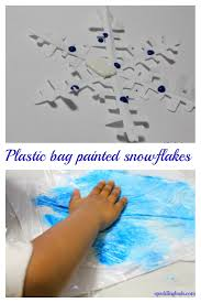 winter craft ideas for preschool painting paper snowflakes