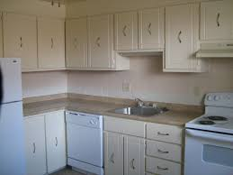 off white kitchen cabinets with white appliances kitchen and decor