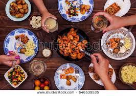 set table to dinner set table dinnersalmon shrimp vegetables stock photo 646539535
