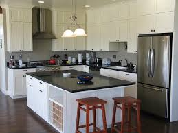 picture of modern kitchen design with square island and black