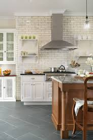 traditional kitchens u shaped kitchen with white subway tile and semi custom brookhaven cabinets with a mix