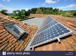 photo voltaic solar panels on the roof of an eco friendly home