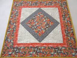 quilted square table toppers table topper quilted floral tabletop by patchworkmountain on zibbet