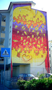 towering murals by blu on the streets of italy confront porto torres 2016