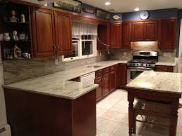 what color granite looks best with cherry cabinets soothing river white granite countertops white