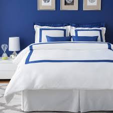 luxury bedroom ideas with royal blue bed sheet with solid white