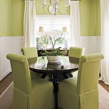 furniture small dining room with round black dining table feat furniture small dining room with round black dining table feat green dining chairs covers under white modern chandelier close to white fabric curtain