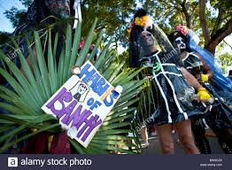 costumed revelers during fantasy fest halloween parade in key west