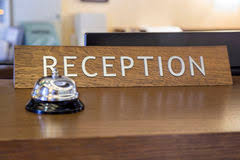 Front Desk Reception Bell With Reception Sign On Front Desk Stock Image Image Of