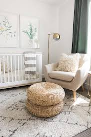 white and green nursery features botanical prints placed over a
