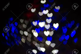 heart shaped christmas lights abstract heart shaped bokeh background of blue and white christmas