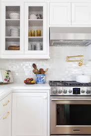 kitchen backsplash behind stove ideas cabinet handles for warming
