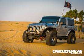 sand jeep wrangler boosted and lifted carculture ae