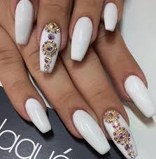 white nails with rhinestones including winter nail design