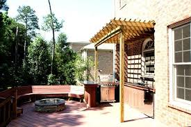 composite deck with small pergola and fire pit outdoor kitchens