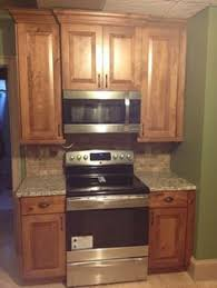 rustic birch cabinets cabinets 855x1319 creative cabinetry