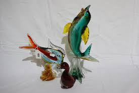 two murano glass fish ornaments together with a whitefriars glass