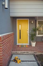 image result for yellow front door on brick house front door