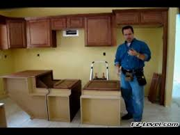 how to attach kitchen base cabinets how to install base cabinets part 1 of 4 wmv