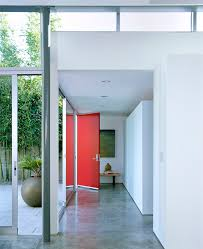 red decorative floor with red entry door entry midcentury and