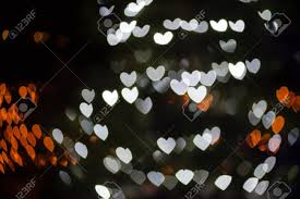 heart shaped christmas lights abstract heart shaped bokeh background of white christmas lights