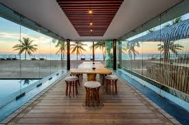 natural nuance futuristic beach house with wooden floor and