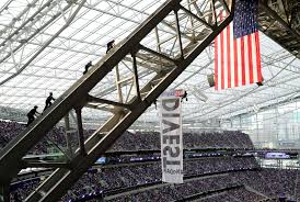 Minneapolis Flag Oil Pipeline Protesters Dangle From Stadium Ceiling During Bears