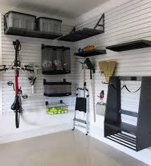 Small Garage Storage Ideas Finished With Black Furntiure Design - Garage interior design ideas