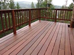 simple country style railing anchors deck brown laminate wood