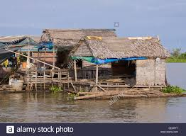 basic floating houses made from wood bamboo and palm frond roofs