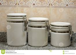 ceramic canisters for the kitchen three white ceramic jars on kitchen counter royalty free stock