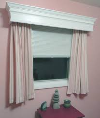 house window decorated with white cornice and short curtains also