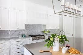 kitchen cabinet corbels with marble backsplash transitional