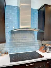 kitchen black and white tile backsplash blue ceramic floor tile