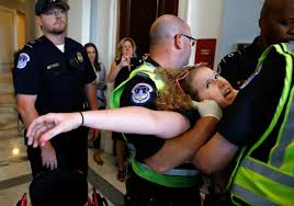 disability advocates removed from senate protest health bill