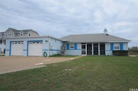 search southern shores homes and beach houses for sale and southern shores oceanfront classic historic southern shores oceanfront home full sized 100 foot wide oceanfront lot with a 1957 built 3 bedroom 3 bath