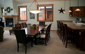 extra seating large dining table and extra seating at the bar home interiors