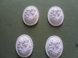 decoration en platre camée en plâtre de porcelaine blanc tête femme ancienne